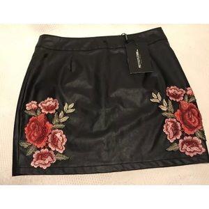 PrettyLittleThing faux leather flower mini skirt